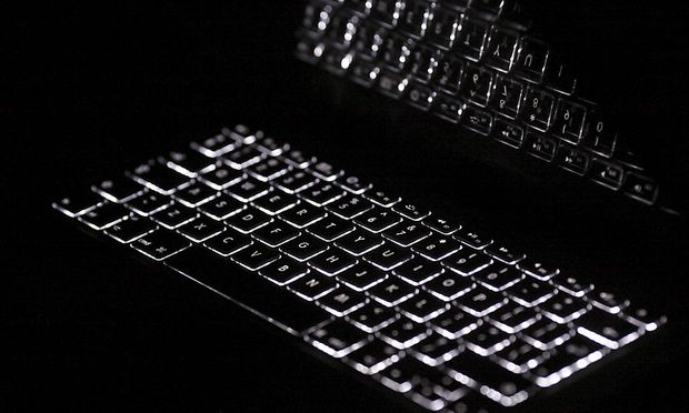 Backlit keyboard is reflected in screen of Apple Macbook Pro notebook computer