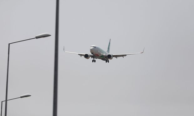 FILE PHOTO: A Transavia Boeing 737 plane prepares to land at Lisbon's airport