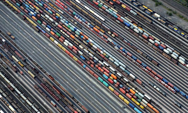 FILE PHOTO: Containers and cars are loaded on freight trains at the railroad shunting yard in Maschen near Hamburg