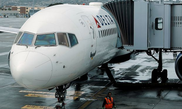 A Delta Airlines plane is seen at a gate in San Diego