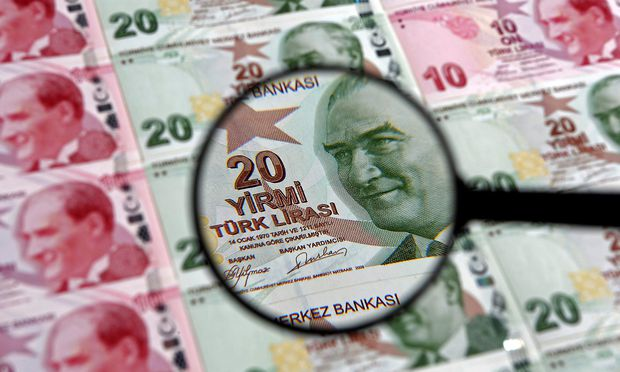 FILE PHOTO: A 20 lira banknote is seen through a magnifying lens in this illustration picture taken in Istanbul