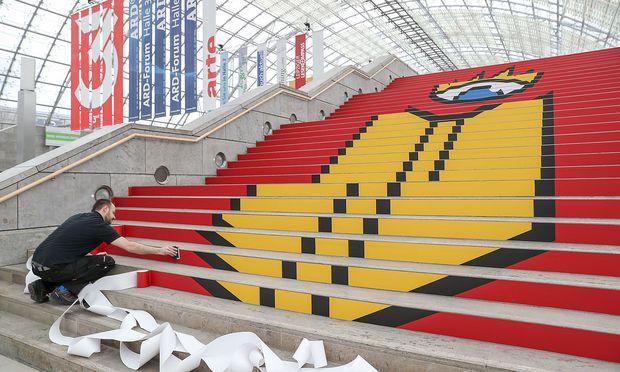 Vorbereitungen zur Leipziger Buchmesse. / Bild: APA/dpa-Zentralbild/Jan Woitas