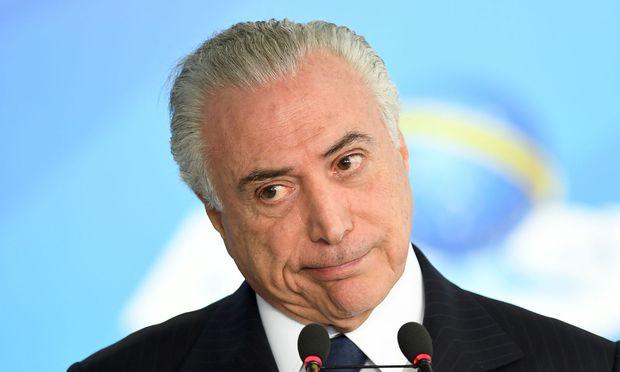 Präsident Michel Temer soll Schweigegeld genommen haben / Bild: AFP (EVARISTO SA)