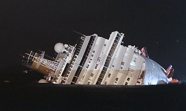 The luxury cruise ship Costa Concordia leans on its side after running aground the tiny Tuscan island