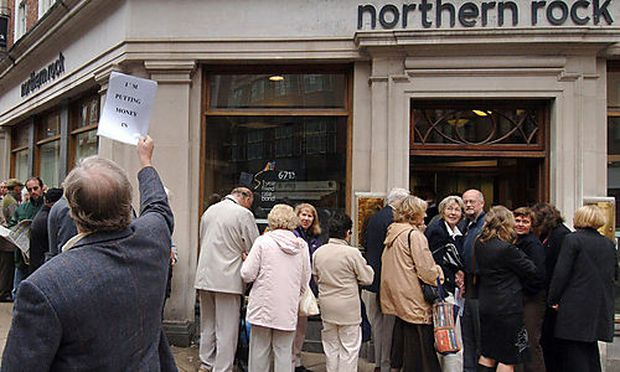 Customers queuing outside a  branch of the British  mortgage lender Northern Rock in York England , a