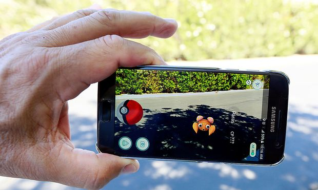 Illustration of the augmented reality mobile game 'Pokemon Go'