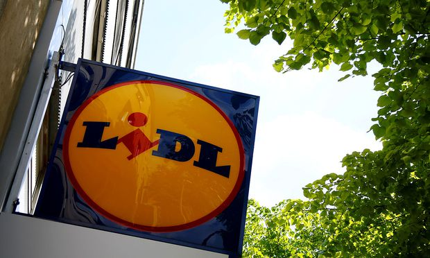 FILE PHOTO: A company logo is pictured outside a Lidl supermarket in Vienna