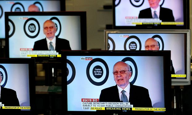 FILE PHOTO: The current Executive Chairman of News Corporation and Executive Co-Chairman of Twenty-First Century Fox, Rupert Murdoch is seen talking on Sky News on television screens in an electrical store in Edinburgh