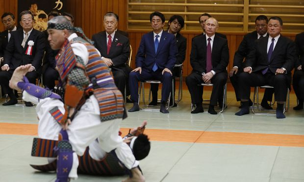 Former Japanese Olympics Judo gold medalist Yamashita, Russian President Putin, Japanese Prime Minister Abe and former Japanese Prime Minister Mori watch a demonstration during their visit at Kodokan judo hall in Tokyo, Japan