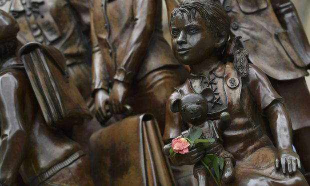 A rose is seen positioned on the Kindertransport memorial outside of Liverpool Street Station in London