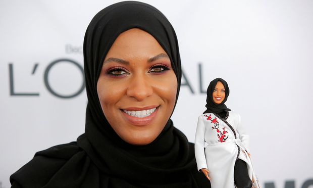 Olympic fencer Ibtihaj Muhammad holds a Barbie doll made in her likeness as she attends the 2017 Glamour Women of the Year Awards at the Kings Theater in Brooklyn New York