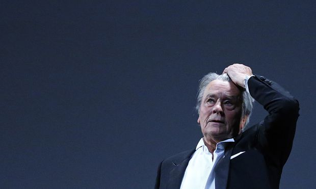 Actor Alain Delon reacts on stage during a tribute for his career before the screening of the restored print of the film ´Plein Soleil´ by Rene Clement during the 66th Cannes Film Festival