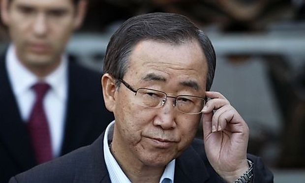 U.N. Secretary-General Ban Ki-moon stands in front of the remains of rockets fired by Palestinian mil
