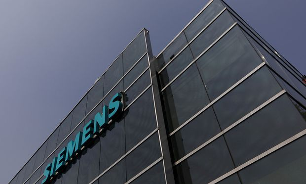 FILE PHOTO: A logo of Siemens is pictured on a building in Mexico City
