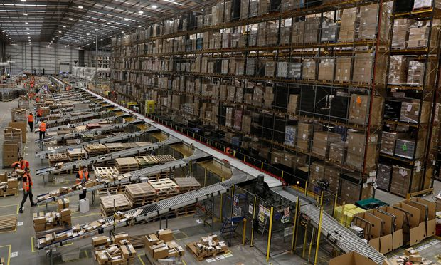 Parcels are sorted for distribution at Amazon's fulfilment centre in Peterborough