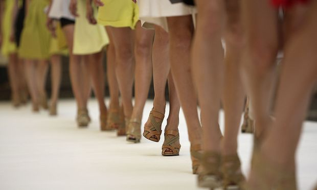 Models walk on the runway during Unique fashion show in London