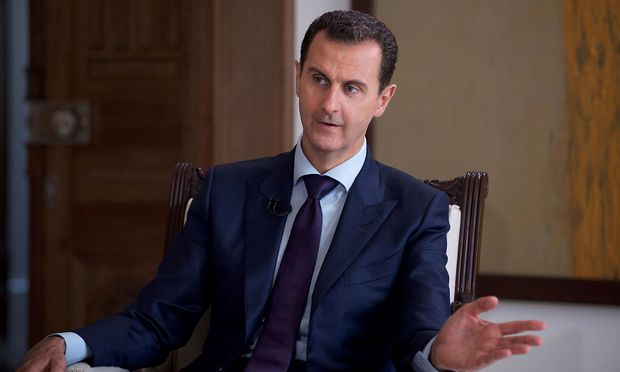 Syria's President Bashar al-Assad speaks during an interview with Australia's SBS News channel in this handout picture provided by SANA