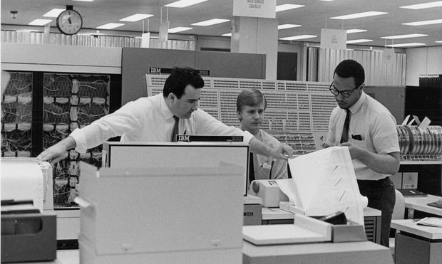 IBM engineers work with a System 360 mainframe computer using business programs written in an early version of the COBOL language in this undated handout photo