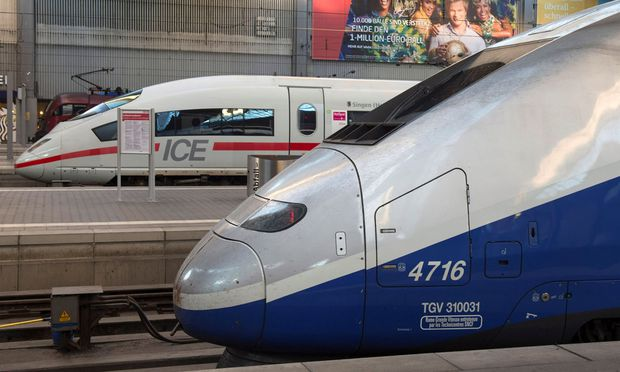 FILE PHOTO: French High Speed Train (TGV) made by French train maker Alstom stops next to German High Speed Train (ICE) made by Siemens at Munich´s railway station