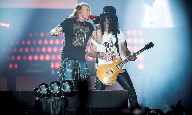 Axl Rose, lead singer of American rock band Guns N' Roses, performs with Slash at Parken Stadium in Copenhagen