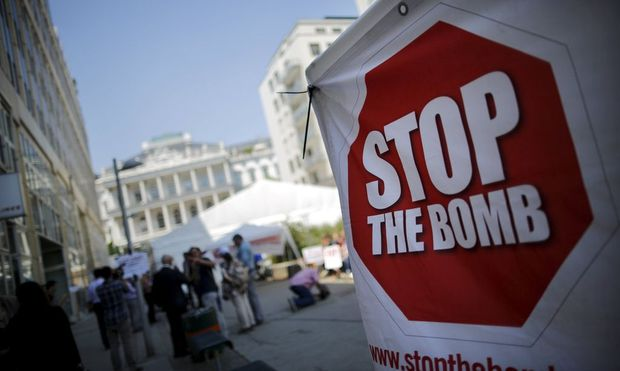A sign which reads 'Stop the Bomb' is seen as protesters gather outside the hotel where the Iran nuclear talks meetings are being held in Vienna, Austria