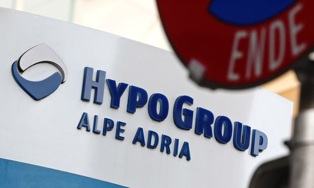 The logo of nationalised Hypo Alpe Adria is pictured at a former branch office of the bank in Klagenfurt