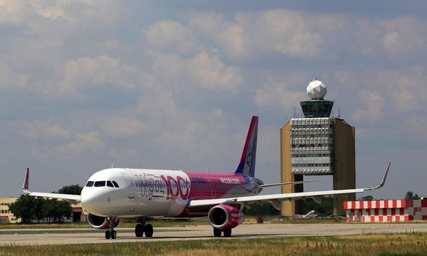 A Wizz Air Airbus A321 aircraft is seen on the tarmac after the unveiling ceremony of the 100th plane of its fleet at Budapest Airport
