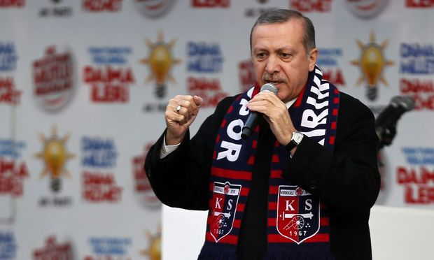 Turkey's Prime Minister Tayyip Erdogan addresses the crowd during an election rally in Kirikkale