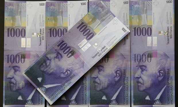 Swiss 1,000-franc notes are seen in this picture illustration