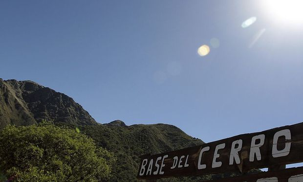 A sign marks the base of the Uritorco hill in the Argentine city of Capilla del Monte in the Cordoba