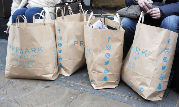 Busy day on Oxford Street in the run up to Christmas London UK Shoppers with shopping bags from Pr