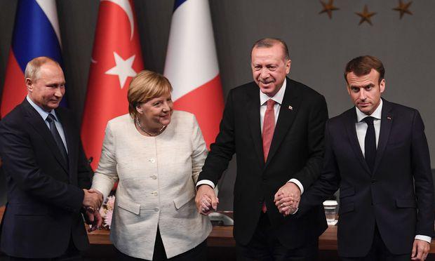 Putin, Merkel, Erdoğan und Macron beim Syrien-Gipfel von Istanbul.