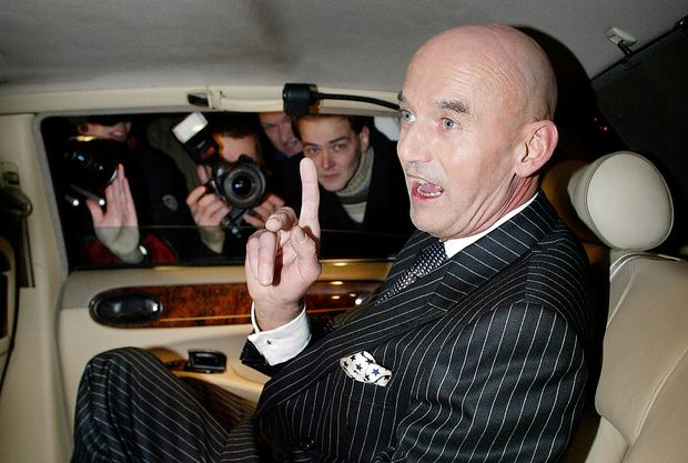 PIM FORTUYN SPEAKS TO PRESS FROM HIS BENTLEY IN A FILE PHOTO.