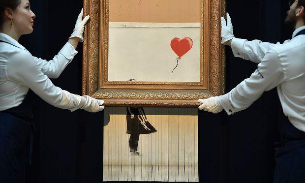 """Das Bild """"Girl With Balloon"""" zerstörte sich im Herbst kurz nach seinem Verkauf an eine europäische Sammlerin."""