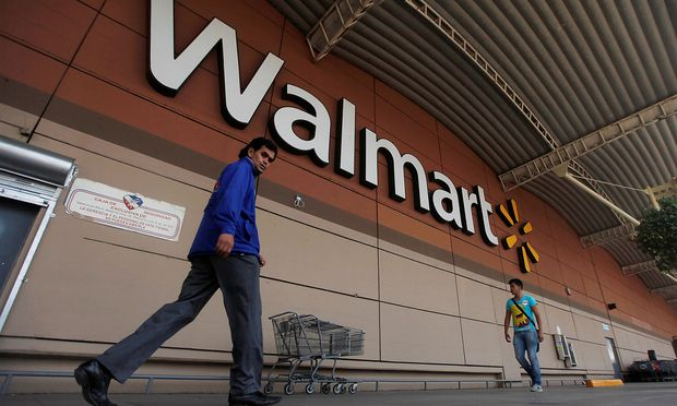 FILE PHOTO: Shoppers walk from a Wal-Mart store in Mexico City