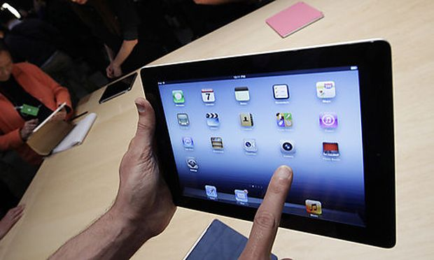 FILE - In this March 7, 2012 file photo, a new Apple iPad is on display during an Apple event in San