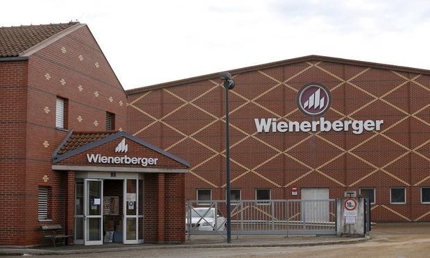 Logos of Wienerberger, the world´s biggest brickmaker, are pictured at its headquarters in Hennersdorf