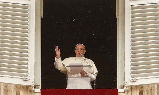 Pope Francis makes a blessing as he arrives for the Angelus prayer in Saint Peter's Square at the Vatican