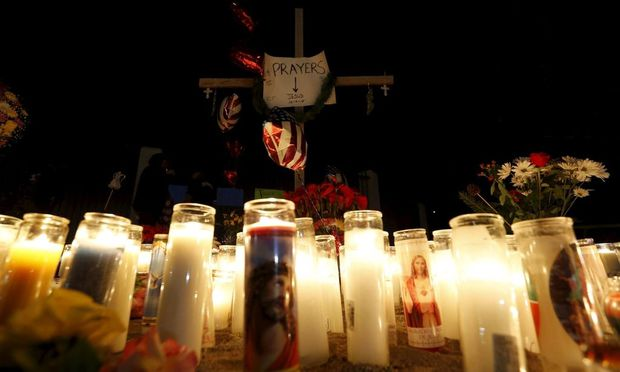 Candles are seen at a pop-up memorial in San Bernardino, California, following Wednesday's attack