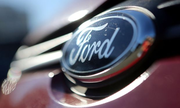 The Ford logo is seen on a car in a park lot in Sao Paulo