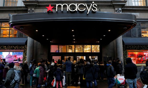 FILE PHOTO: People gather at Macy's Herald Square store ahead of early opening for the Black Friday sales in Manhattan