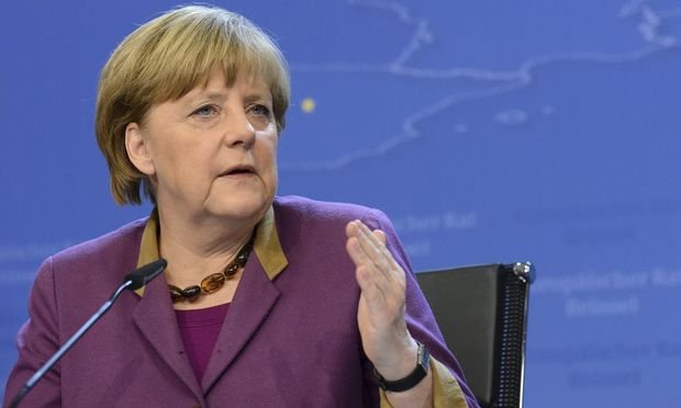 Germany's Chancellor Angela Merkel holds a news conference at the end of a European Union leaders summit in Brussels