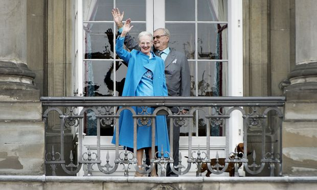 FILE PHOTO: Denmark´s Queen Margrethe and Prince Henrik wave from the balcony during Queen Margrethe´s 76th birthday celebration at Amalienborg Palace in Copenhagen