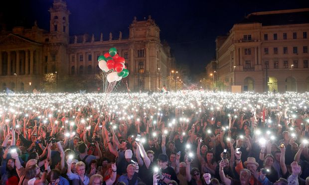 People attend a protest against the government of Prime Minister Viktor Orban in Budapest