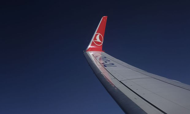 The logo of Turkish Airlines (THY) is pictured on the wing of a Boeing 737-900 ER aircraft as it gets ready to land at Ataturk International airport in Istanbul