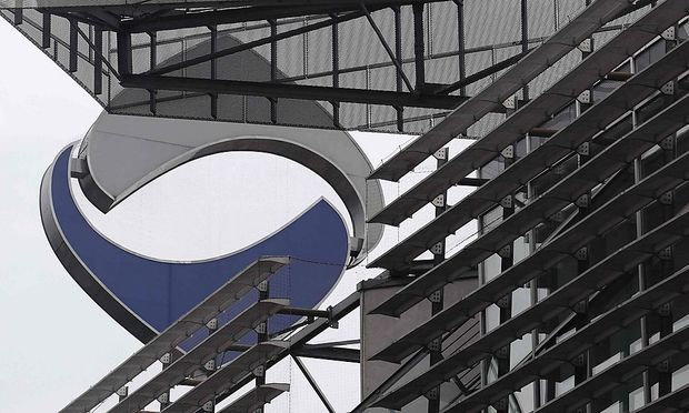The logo of nationalised lender Hypo Alpe Adria is pictured atop the bank's headquarters in Klagenfurt