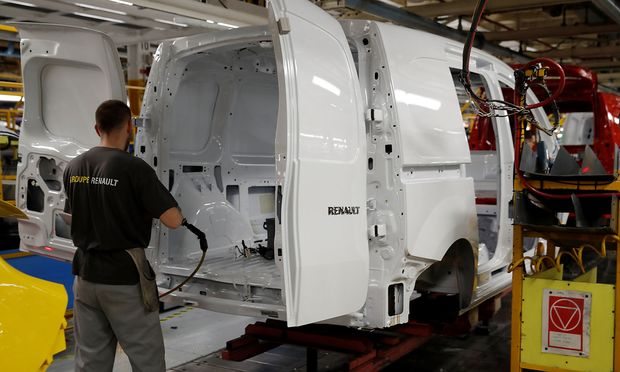 An employee works on the production and quality control line of the Renault Kangoo car at the Renault Maubeuge Construction Automobile factory in Maubeuge