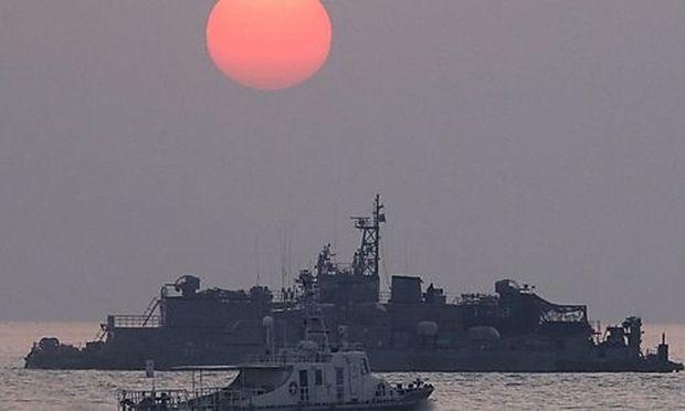 The sun rises as South Korean navy ships patrol off Yeonpyeong island