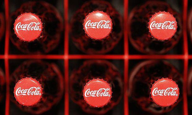 Logos are seen on Coca-Cola bottles