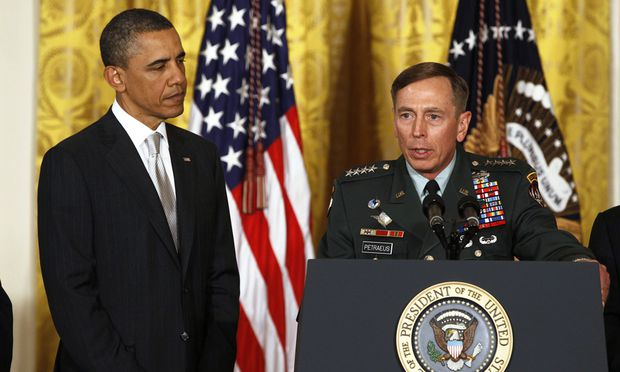 File photo of U.S. Army Gen. Petraeus and U.S. President Obama at event in the East Room of the White House